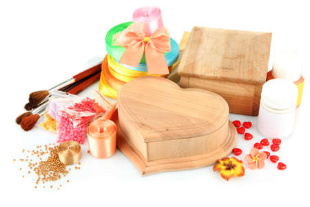 Handmade wooden boxes and art materials for decor, isolated on white photo