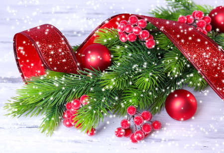 Christmas balls on fir tree, on wooden background photo