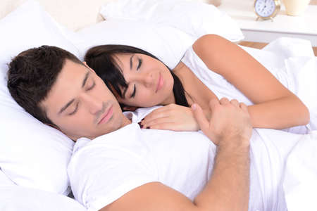 Couple in love sleeping in bed Stock Photo - 24176639