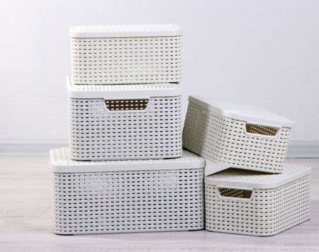 roomy: Plastic baskets for storing things in floor on room background
