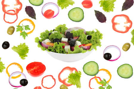 Fresh mixed vegetables around bowl of salad close up photo