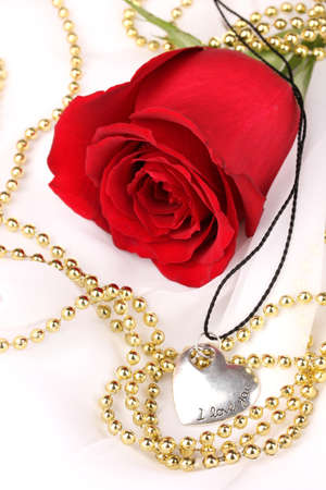 Beautiful red rose with heart pendant photo