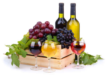 winy: bottles and glasses of wine and assortment of grapes in wooden crate, isolated on white Stock Photo