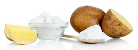 starch: Starch in spoon with potatoes isolated on white