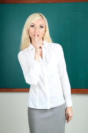 require: School teacher require silence in classroom