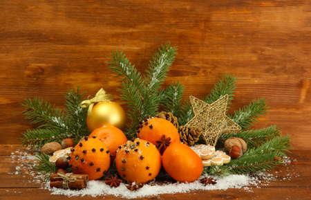 christmas composition with oranges and fir tree, on wooden  photo