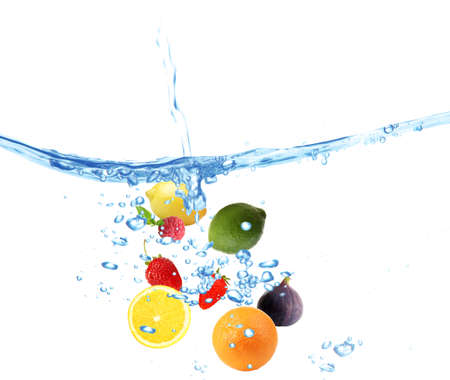 Fresh fruits dropped into water photo