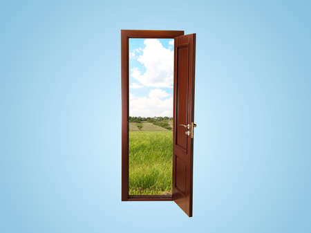 Field view through an open door on blue background photo