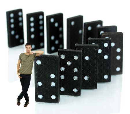 Young man with dominoes isolated on white photo