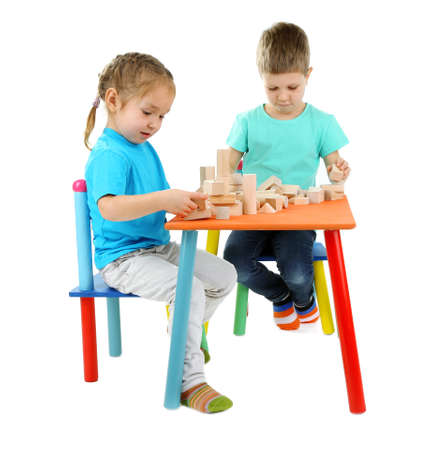 Little children playing with building blocks isolated on white photo