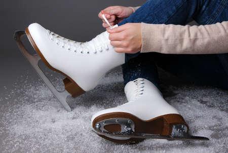 Skater wearing skates on gray background photo