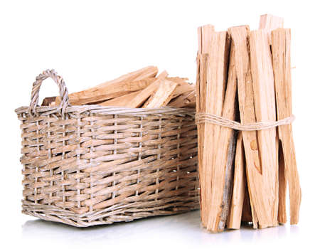 billet: Stack of firewood in wicker basket isolated on white
