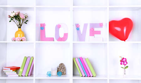 White shelves decorated with handmade knit word photo