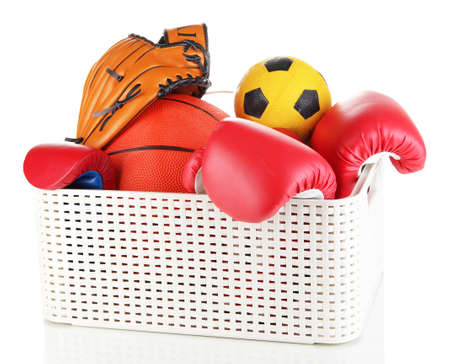 storing: Plastic basket with sports equipment isolated on white