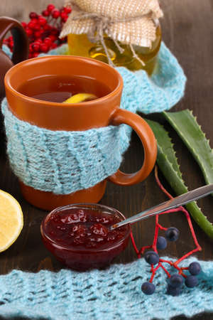 convalesce: Helpful tea with jam for immunity on wooden table close-up Stock Photo