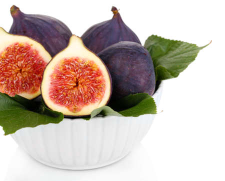 Ripe figs in bowl isolated on white photo