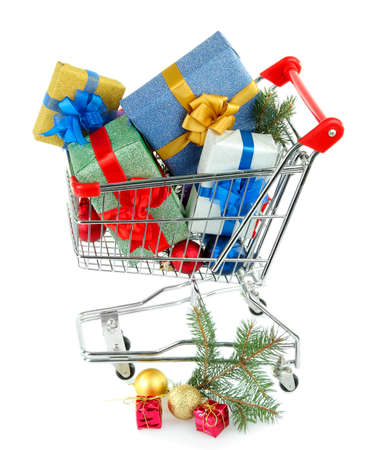 Christmas gifts in shopping trolley, isolated on white photo