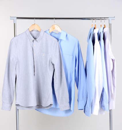 Office male clothes on hangers, on gray  Stock Photo - 24341113