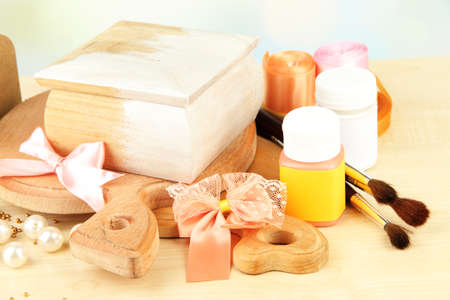 Handmade wooden box and art materials for decor, on table photo