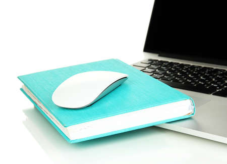 repository: Computer mouse on book and notebook isolated on white Stock Photo