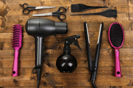 hair design salon: Hairdressing tools on wooden table close-up