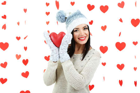 Attractive young woman with heart on Valentine Day photo