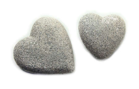 cold blooded: Grey stones in shape of heart, isolated on white