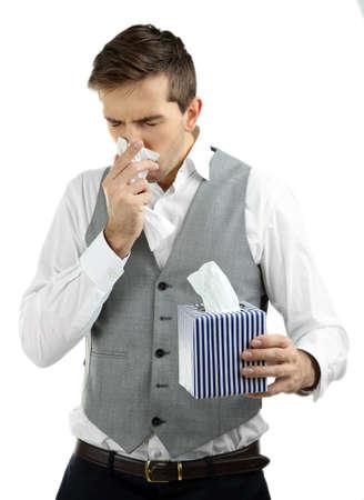 Sneezing young man isolated on white Stock Photo