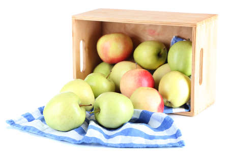 Juicy apples on napkin in box isolated on white photo