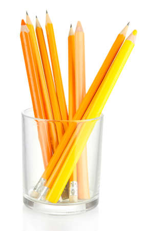 Pencils in glass isolated on white photo