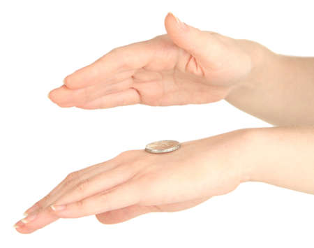 Hands of woman flipping coin isolated on white photo