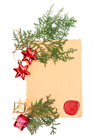 Frame with vintage paper and Christmas decorations isolated on white photo
