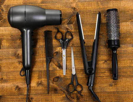 curling irons: Hairdressing tools on wooden table close-up