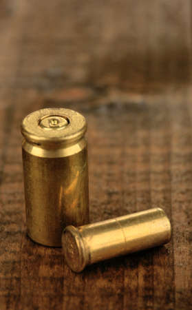 Shotgun cartridges on wooden table close-up photo
