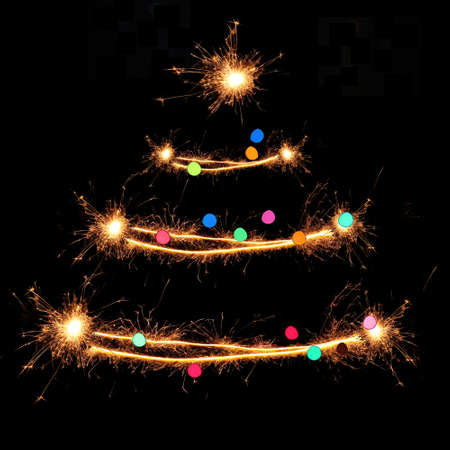 sparklet: Sparklers in Christmas tree-shaped Stock Photo