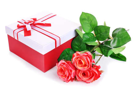 Beautiful gift box with flowers isolated on white photo
