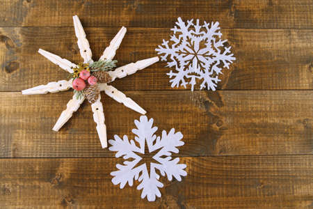 Beautiful snowflakes on wooden background photo