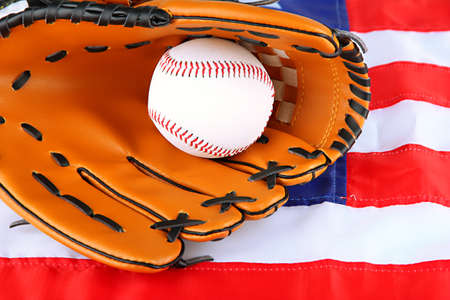 Baseball glove and ball on American flag background photo