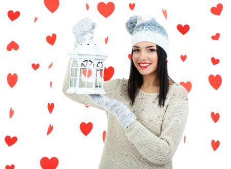 Attractive young woman with lantern on Valentine Day photo