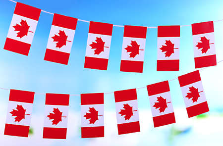 Garland of flags on bright background Stock Photo