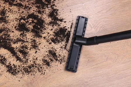 untidiness: Vacuuming floor in house