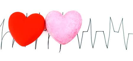 Hearts on cardiogram background, isolated on white Stock Photo - 24551937