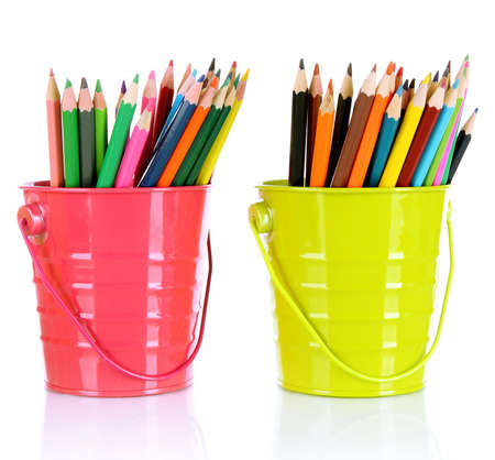 Colorful pencils in two pails isolated on white photo
