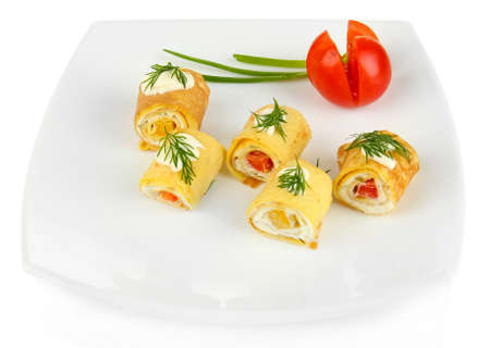 Egg rolls with cheese cream and paprika,on plate, isolated on white  photo