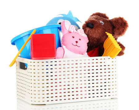 roomy: Plastic basket with toys isolated on white