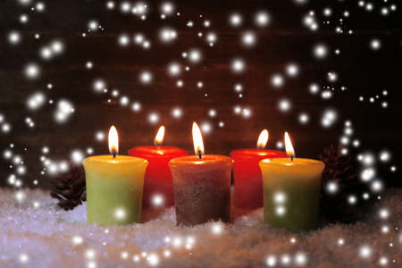 Burning candles on wooden  photo