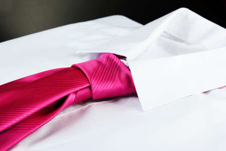 drycleaning: tie on shirt isolated on black Stock Photo
