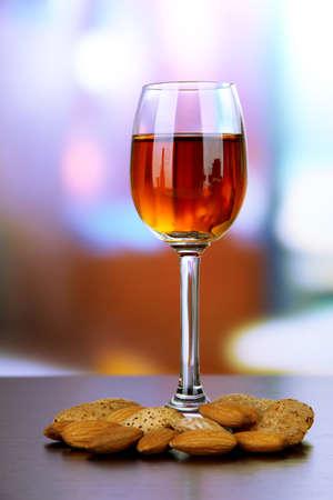 amaretto: Glass of amaretto liquor and roasted almonds
