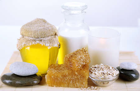 humidify: Honey and milk spa with oils and honey isolated on white Stock Photo