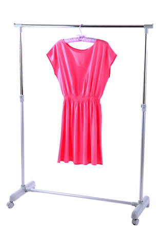 Beautiful pink dress hanging on hangers isolated on white photo